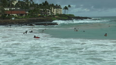 Surfer in dramatic waves at poipu beach, kaui hawaii Stock Footage