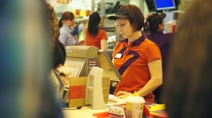Cash desk with cashier in fast food restaurant Stock Footage