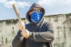 Man with a baseball bat at outdoor - stock photo