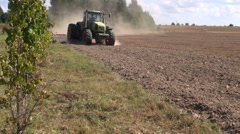 Tractor cultivated farm field Stock Footage