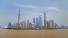 Ships through the skyline of Shanghai,China. Stock Footage