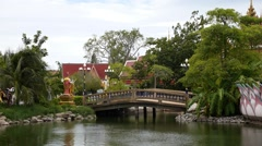 Small Thai Style Bridge Over Pond. Stock Footage