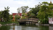 Stock Video Footage of Small Thai Style Bridge Over Pond.