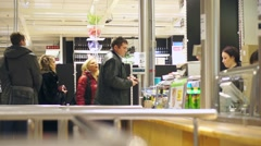 Customers at cafe's cash desk in huge department and furniture store - stock footage