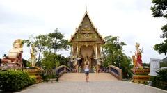 Girl Photographing Buddhist Pagoda, Wat Plai Laem. Stock Footage