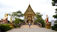 Stock Video Footage of Girl Photographing Buddhist Pagoda, Wat Plai Laem.
