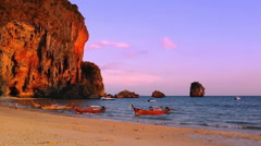 Phuket travel destination background. Mountain cliff, sandy beach and boat Stock Footage