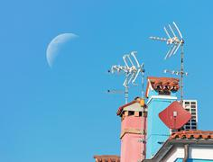 Moon over antennas Stock Photos