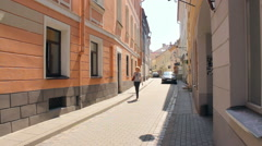 Stiklių street in the old town of Vilnius in summer, panning Stock Footage