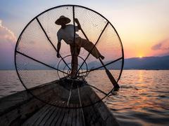 Fisherman in Inle Lake at Sunset, Inle, Shan State, Myanmar Stock Photos