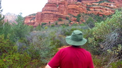 Man Hiking Trail Away From Camera In Boynton Canyon- Sedona AZ Stock Footage