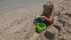 Child Playing with Sand Castles, Little Girl on Tropical Exotic Beach, Coastline Stock Footage