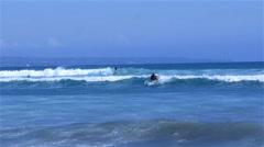 Surfer sliding on sea waves Stock Footage