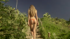 Rio De Janeiro bikini model walks up the stairs Stock Footage