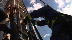 Drilling Rig Worker Climbing Derrick Wide Stock Footage