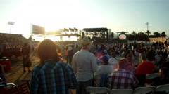 Big crowd for summer concert at sunset outdoors cutaway transition Stock Footage