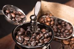 Coffee beans with coffee grinder Kuvituskuvat