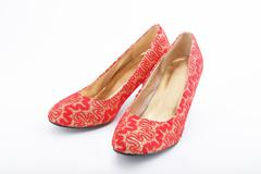 Beautiful chinese embroidered wedding shoes isolated on white Stock Photos