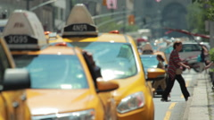 Cars yellow cabs traffic on Park Avenue in New York City - stock footage