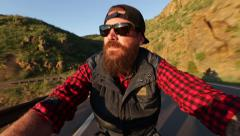 Hipster biker riding motorcycle in mountain sunrise Stock Footage