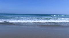 Handheld shot of sea splashing on sand beach Stock Footage
