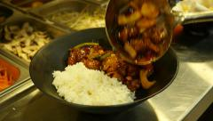 Asian dish - Rice with chicken and vegetables Stock Footage
