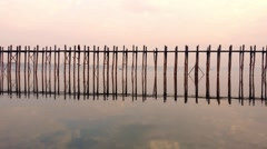 U Bein wooden bridge in Myanmar. Sunset peaceful landscape view Stock Footage