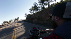 Biker riding vintage motorcycle on curvy mountain road - 2 shots Stock Footage