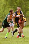 Player avoids being tackled in amateur australian rules football game Stock Photos