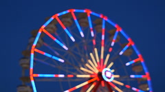 Defocused Ferris Wheel Spinning at Twilight 1 Stock Footage