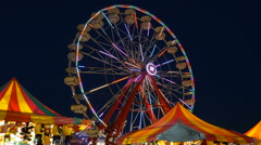 Ferris Wheel Spinning at Twilight 4 Stock Footage