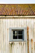 Metal outbuilding roof window forgotten coast guard lighthouse Stock Photos