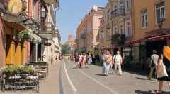 Pilies street with people in the old town of Vilnius, Gediminas' Tower, static Stock Footage
