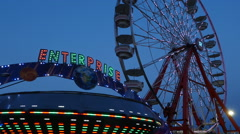 Enterprise and Ferris Wheel Spinning at Twilight 1 Stock Footage