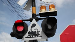 Train signals at road crossing Stock Footage