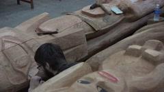 Totem Poles, carver artisan Stock Footage