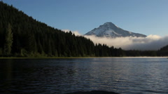 Clouds Over Trillium Lake with Mount Hood in Oregon One Early Morning at Sunrise Stock Footage