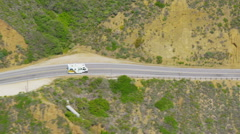 Aerial view RV Motor home on California Coastal road Stock Footage
