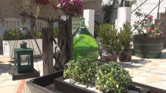 A large bottle of green alchool in front of a market. Weighing a bottle. Stock Footage