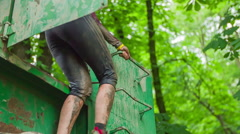 Woman going through obstacle course Stock Footage