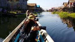 Foreign tourists on boat at Inle Lake travel trip to countryside Stock Footage