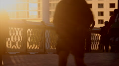 Walking towards the last light on city paving Stock Footage