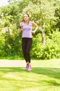 fitness young woman jogging in the park.running woman. - stock photo