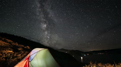 Milky way rotating above tent at night. time lapse Stock Footage