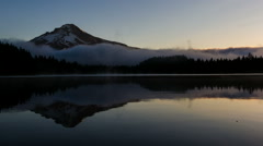Rolling Fog and Clouds Over Trillium Lake with Mt Hood in Oregon at Sunrise Stock Footage