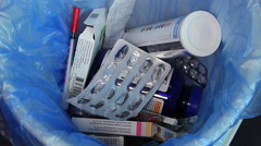 Throwing empty medicine packings trash, used expired medicaments - stock footage