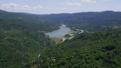 Aerial view of forest and reservoir - stock footage