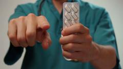 Doctor giving strict order patient, taking prescribed medication - stock footage