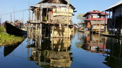 Wooden houses of floating traditional village in Burma, Inle Lake Stock Footage