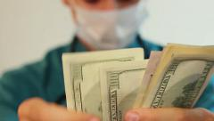 Stock Video Footage of Doctor counting money, corrupt health-care system, insurance
